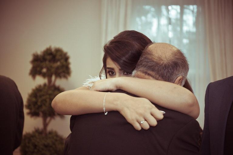 bride hugs grandfather on wedding day
